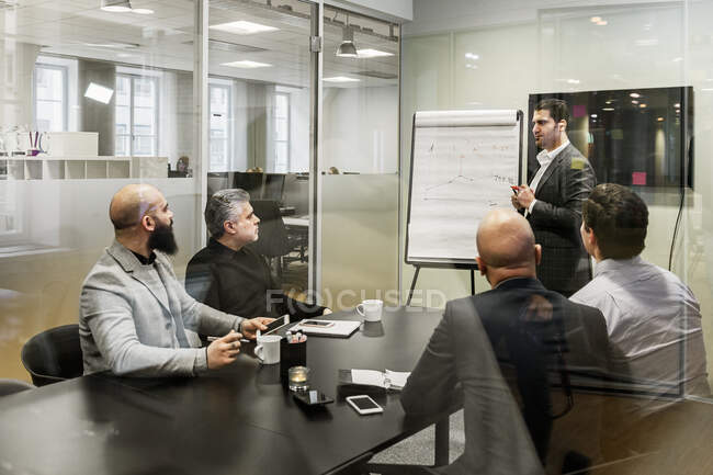 Men discussing project during business meeting in office — Stock Photo
