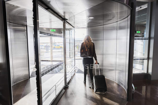 Young woman pulling suitcase, selective focus — Foto stock