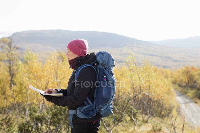 Woman using compass and map, selective focus — Stock Photo