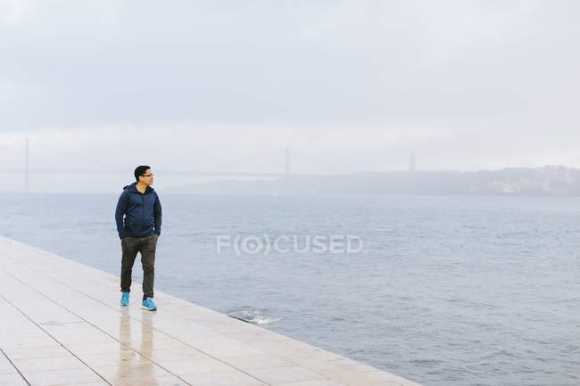 Man walking by Tagus river in Portugal — Stock Photo