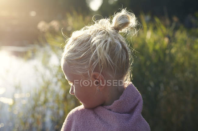 Profile of girl with hair tied back — Stock Photo