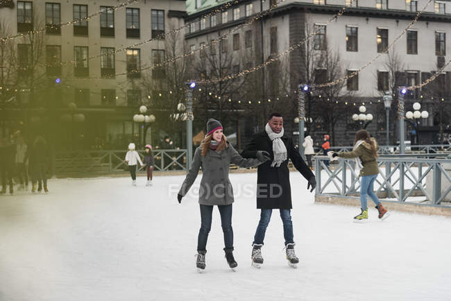 Couple ice skating, selective focus — Stock Photo