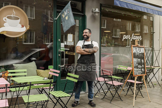 Small business owner outside cafe, selective focus — Stock Photo