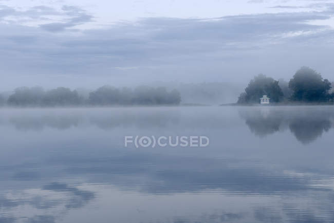 Morning fog over lake, selective focus — Stock Photo