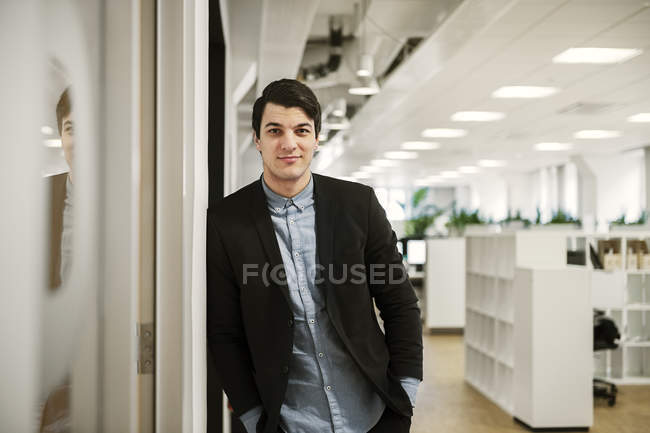 Portrait of young man in office — Stock Photo