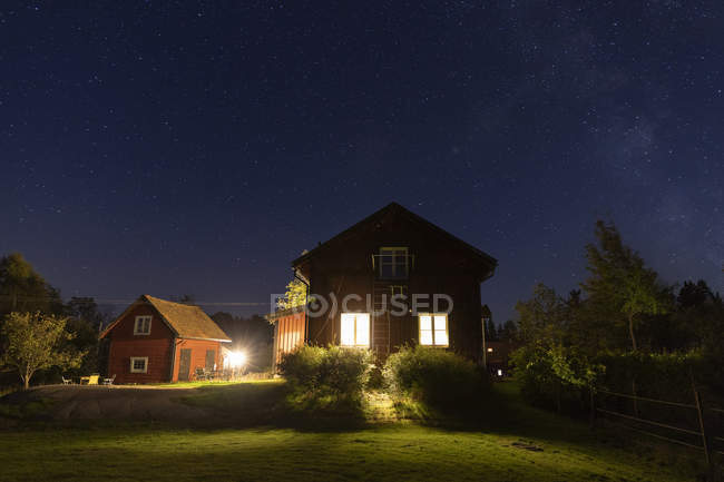Scenic view of houses at night — Stock Photo