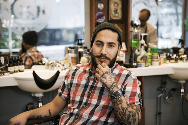 Portrait of barber sitting in barbers chair — Stock Photo