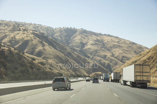 Scenic view of road by hills — Stock Photo