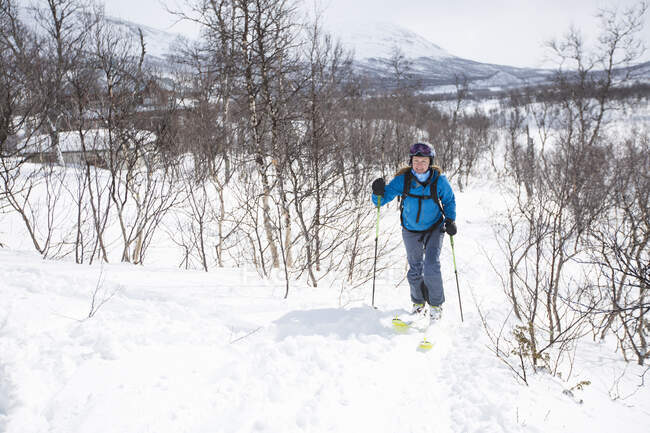 Woman cross country skiing at wintertime — Stock Photo