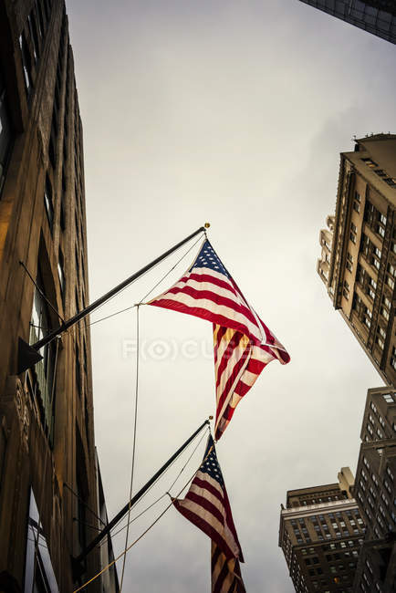 American Flags hanging from building — Stock Photo