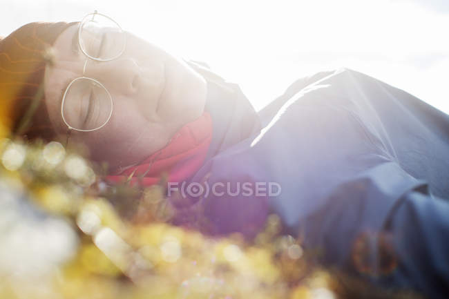Woman napping in sunlight, selective focus — Stock Photo
