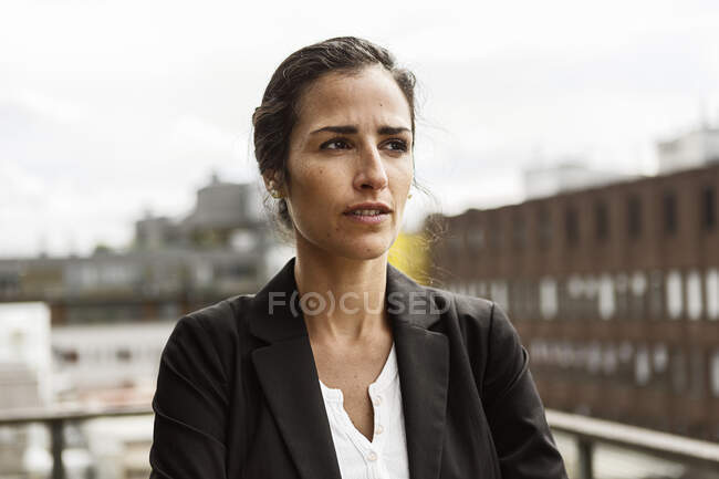 Mid adult woman in urban scene, looking aside — Stock Photo