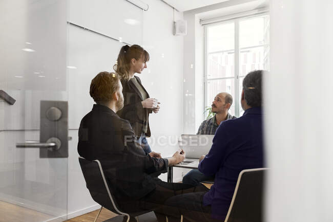 Business people discussing project and looking at each other during meeting — Stock Photo