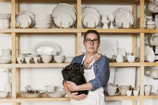 Portrait of woman holding vase, selective focus — Stock Photo