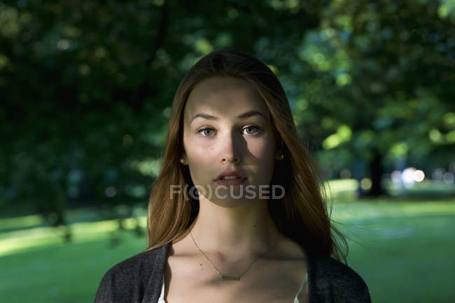 Portrait of young woman in shadow — Stock Photo