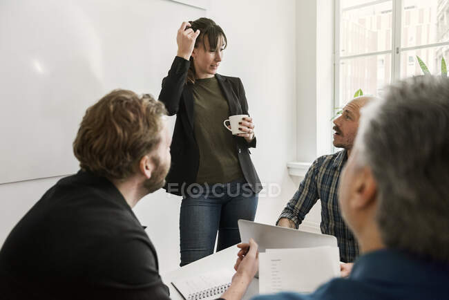 Businesspeople looking at each other and discussing project during meeting — Stock Photo