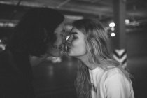 Young couple sensually touching with noses — Stock Photo