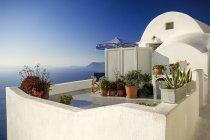 Tipica casa bianca a Oia, Santorini, Grecia — Foto stock