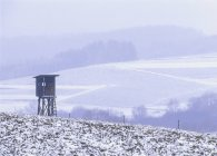 Jaegerstand in winter over snowy fields and hills on background — Stock Photo