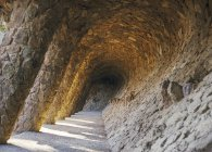 Gallery walkway made of natural stone, Guell Park, Barcelona — Stock Photo