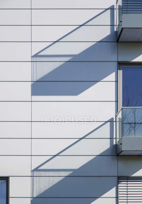 Facade with balconies, shadows, detail — Stock Photo