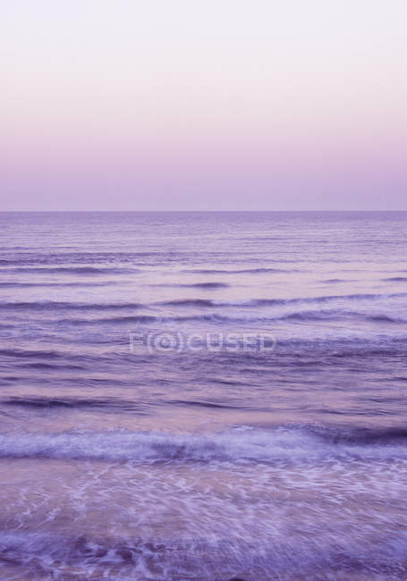 Low waves at beach, morning mood — Stock Photo
