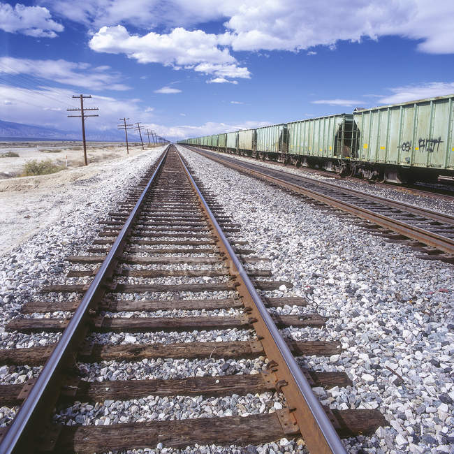 Straight train tracks, cargo train outdoors — Stock Photo