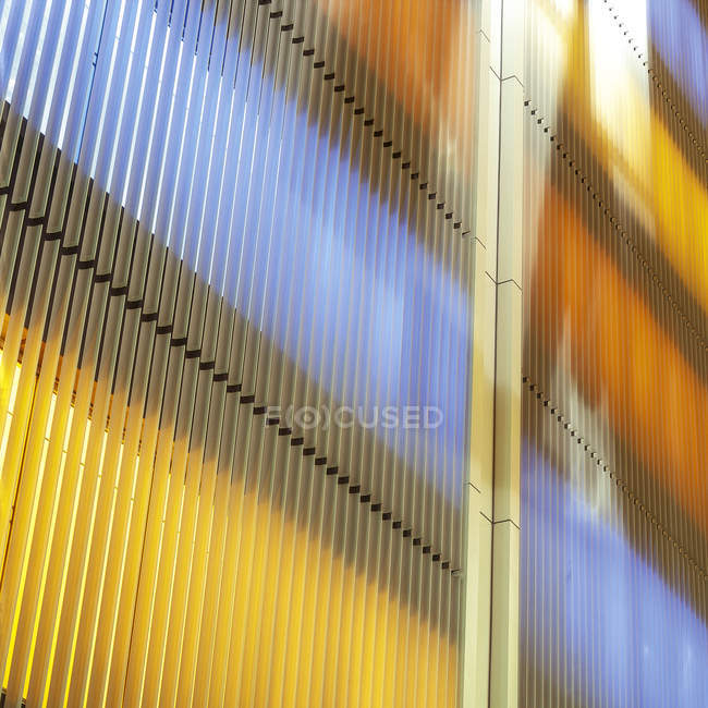 Slats on colored illuminated facade — Stock Photo