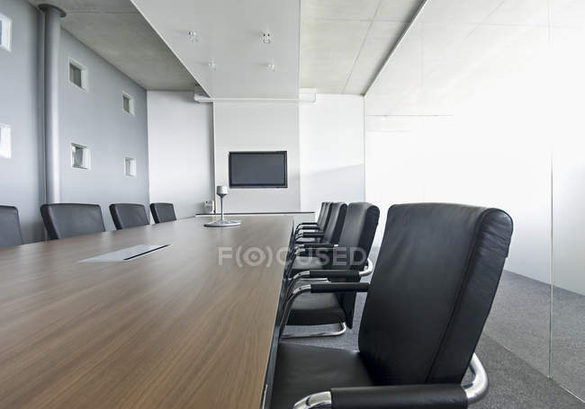 Conference room with table and chairs — Stock Photo