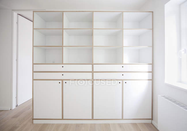 White living room with white cupboard — Stock Photo