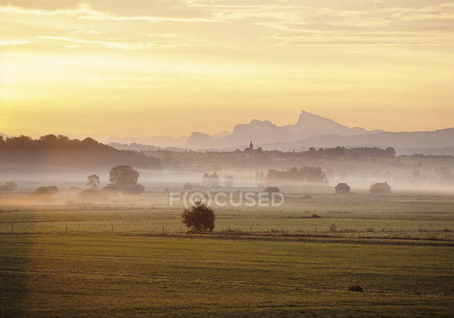 Prealpine landscape in morning mist, Upper Bavaria, Germany — Stock Photo