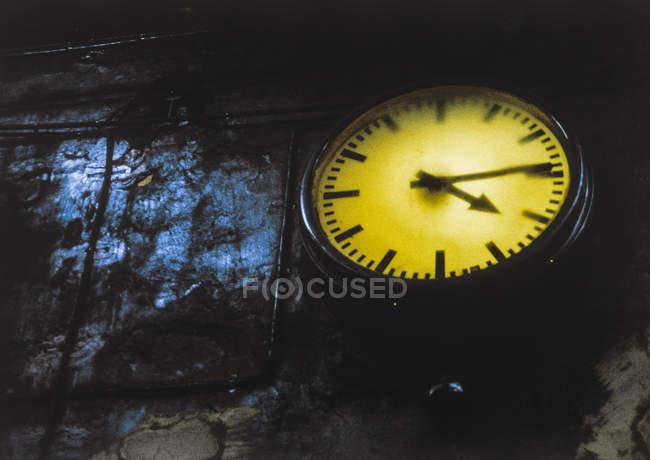 Retro Clock at old factory wall — Stock Photo