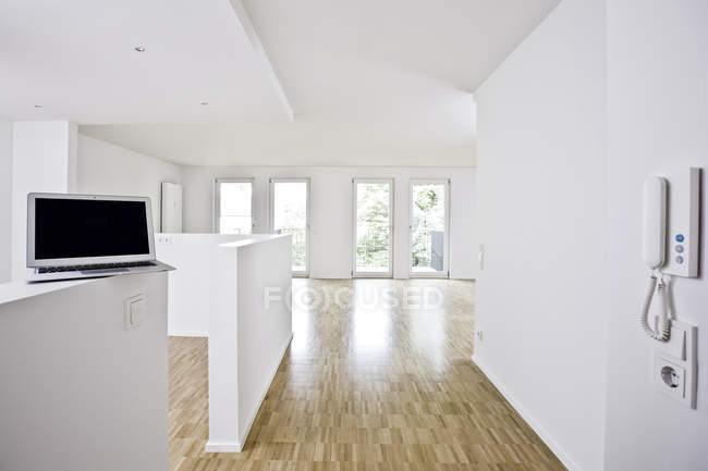 Living room with parquet floor and building services — Stock Photo