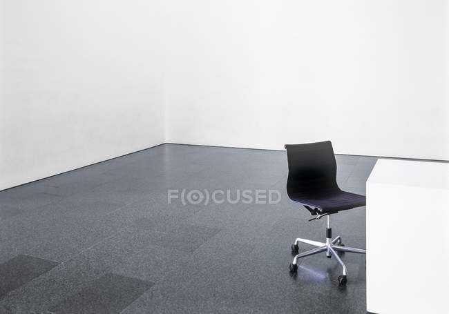 Office chair in empty room indoors — Stock Photo