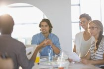Creative business people brainstorming, planning in conference room meeting — Stock Photo