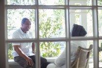 Happy senior couple talking on porch — Stock Photo