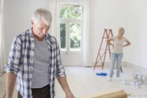 Older couple observing new living space — Stock Photo