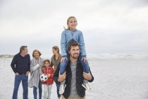 Multi-generation family walking on winter beach — Stock Photo