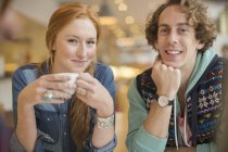 Happy young couple smiling together in cafe — Stock Photo