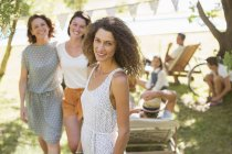 Happy beautiful woman smiling outdoors with family near — Stock Photo