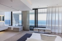 Modern bedroom overlooking ocean — Stock Photo