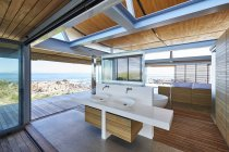 Modern luxury home showcase bathroom open to patio with ocean view — Stock Photo