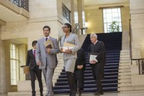 Judges and lawyer walking through courthouse — Stock Photo