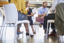 Business people talking in meeting circle at modern office — Stock Photo