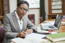 Lawyer taking notes in chambers — Stock Photo