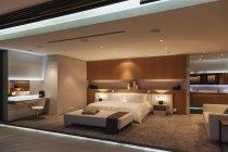Cozy bedroom in modern house interior — Stock Photo