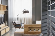 Chair and lamp in modern living room — Stock Photo