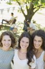 Happy beautiful three women hugging outdoors — Stock Photo