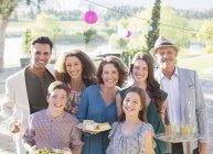 Happy modern family smiling together outdoors — Stock Photo
