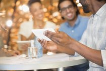 Business people using digital tablet in meeting — Stock Photo